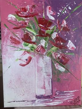 Bouquet champêtre sur fond rose.