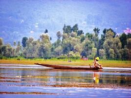 Pêcheur sur le lac Dahl Kashmir