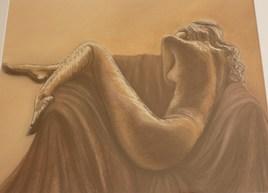 Femme nue sur canapé