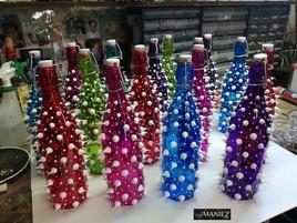 Lot de bouteilles colorées en verre, silicone blanc de MANIEZ Eddy