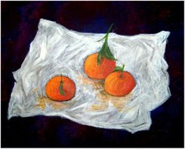 Trois mandarines sur feuille d'alu.