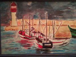 Bateaux entrant au port avant tempête
