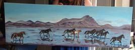 Un groupe de  poneys sur le sable mouillé   115 CM X 40 CM