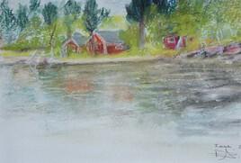 cabanes au bord d'un lac en Laponie