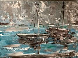 Bateaux sous ciel orageux