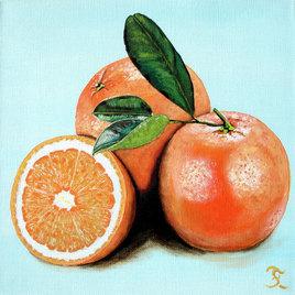 Trois orange sur fond bleu