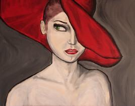 La moue sous un chapeau rouge