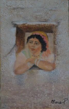 Femme berbère à sa fenêtre.