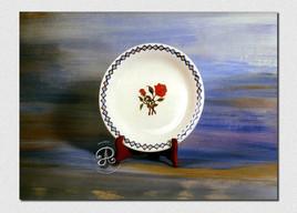 Assiette avec décor de roses