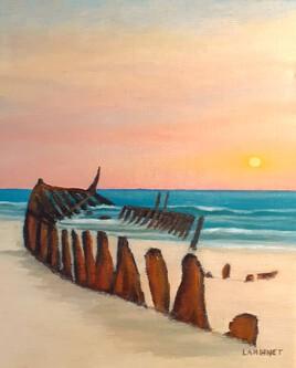 Epave de bateau au coucher de soleil
