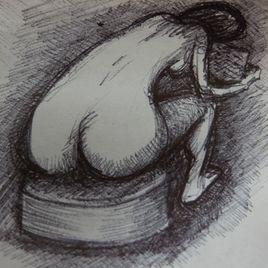 Lecture nue sur pouf